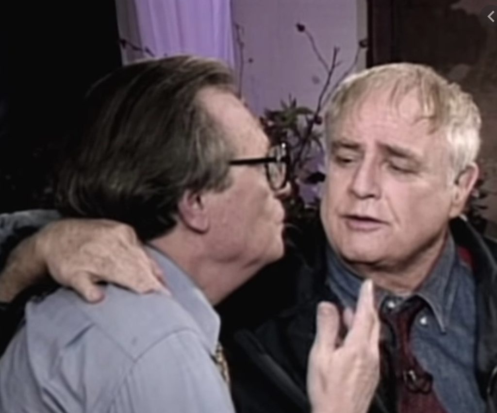 Actor Marlon Brando with Larry King during a taping of his show in 1994.