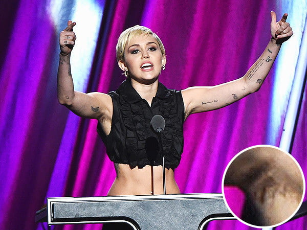 Miley Cyrus shows off her armpit hair