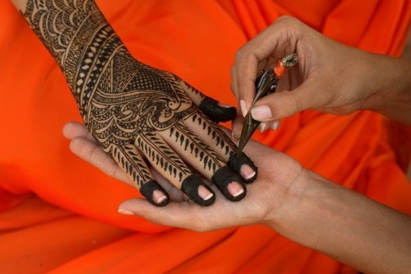 Mehndi is applied with the tip of a tiny plastic cone, allowing for complex designs.