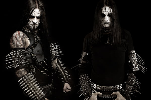Band members from Gorgoroth are showing off classic black metal style with huge spiked gauntlets.