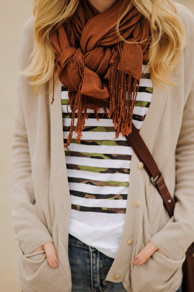 Try knotting your scarf to add a fun touch to your outfit.
