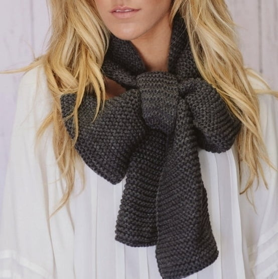 Simply tie your scarf in a bow to add a cute, flirty vibe to your outfit!