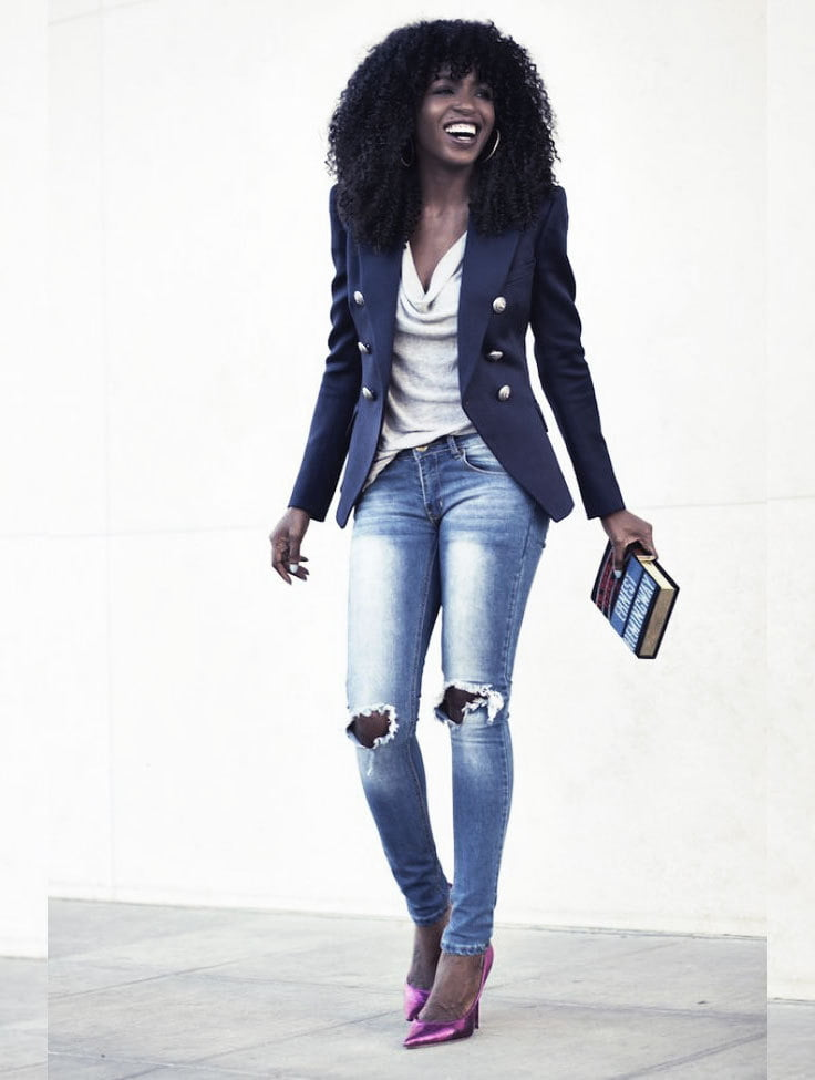 Distressed denim styled for the workplace.