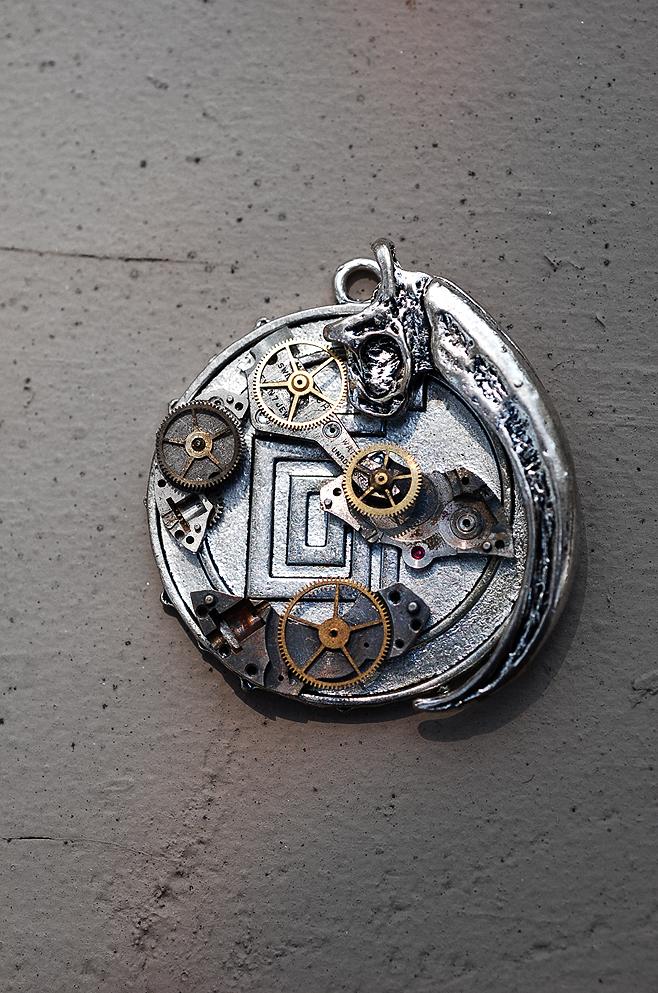 steampunk raptor claw pendant