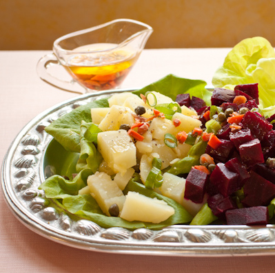 Beet-potato-carrot salad with pickles and capers