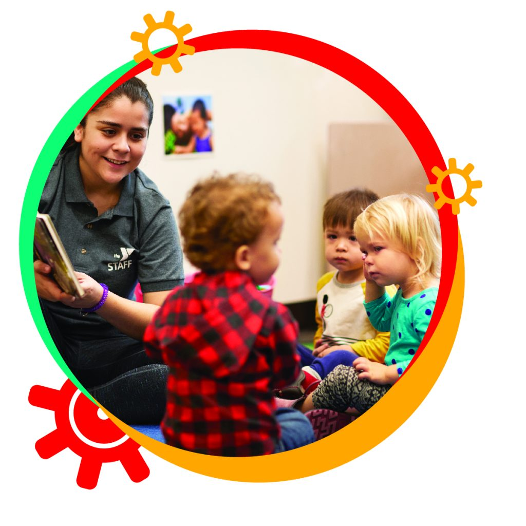 Staff at YMCA Child Development Academy child care read books to infants, toddlers and children