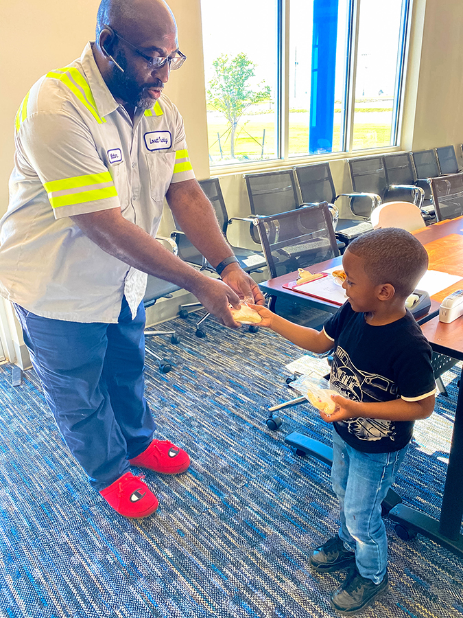 Young boy giving cookies to his dad