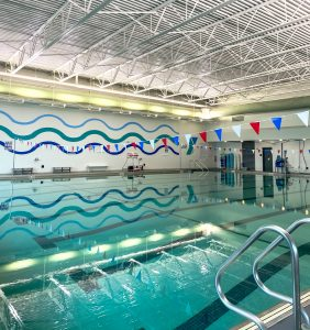 Indoor pool at the Wilson Family YMCA used for swim lessons lap lanes water exercise classes