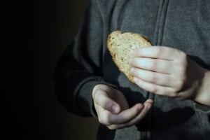 Piece of bread in hands