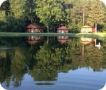Cabins in pond reflection-rounded