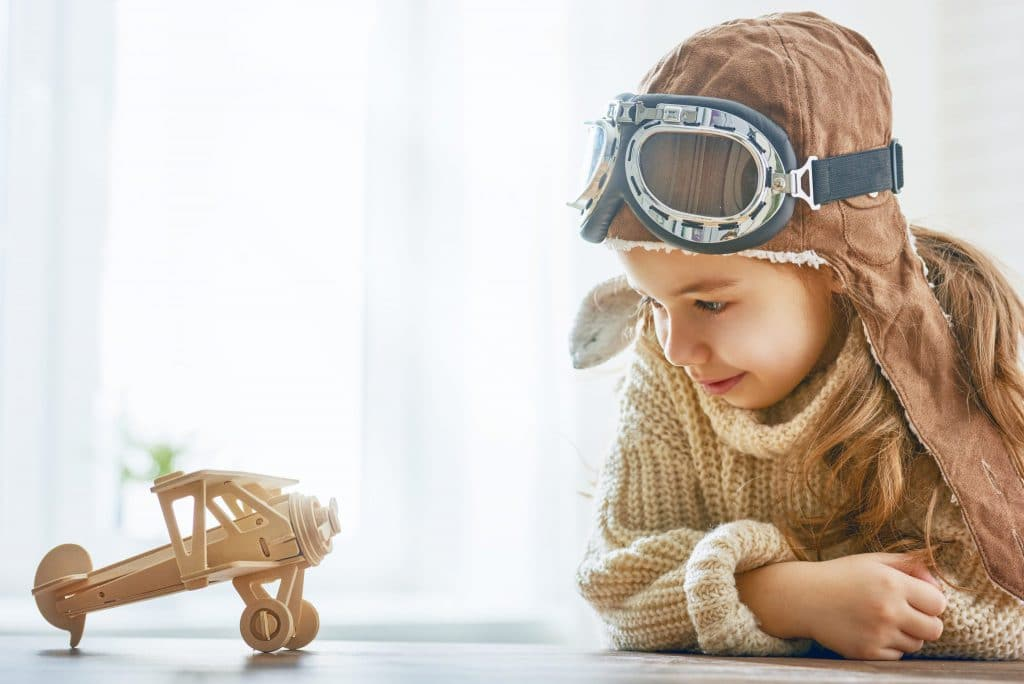 girl-playing-with-toy-airplane-P8LN4LC