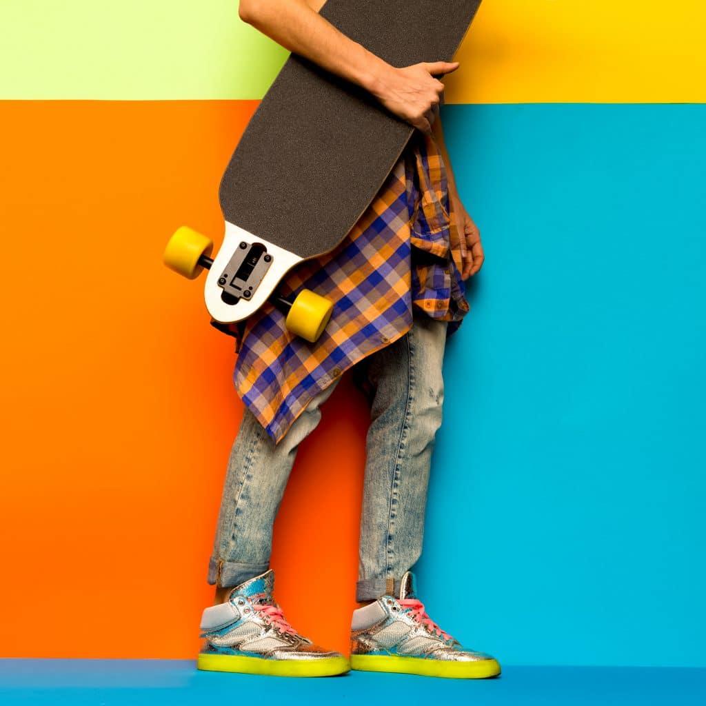 Skateboard Fashion Girl. Minimal design. Stylish clothes
