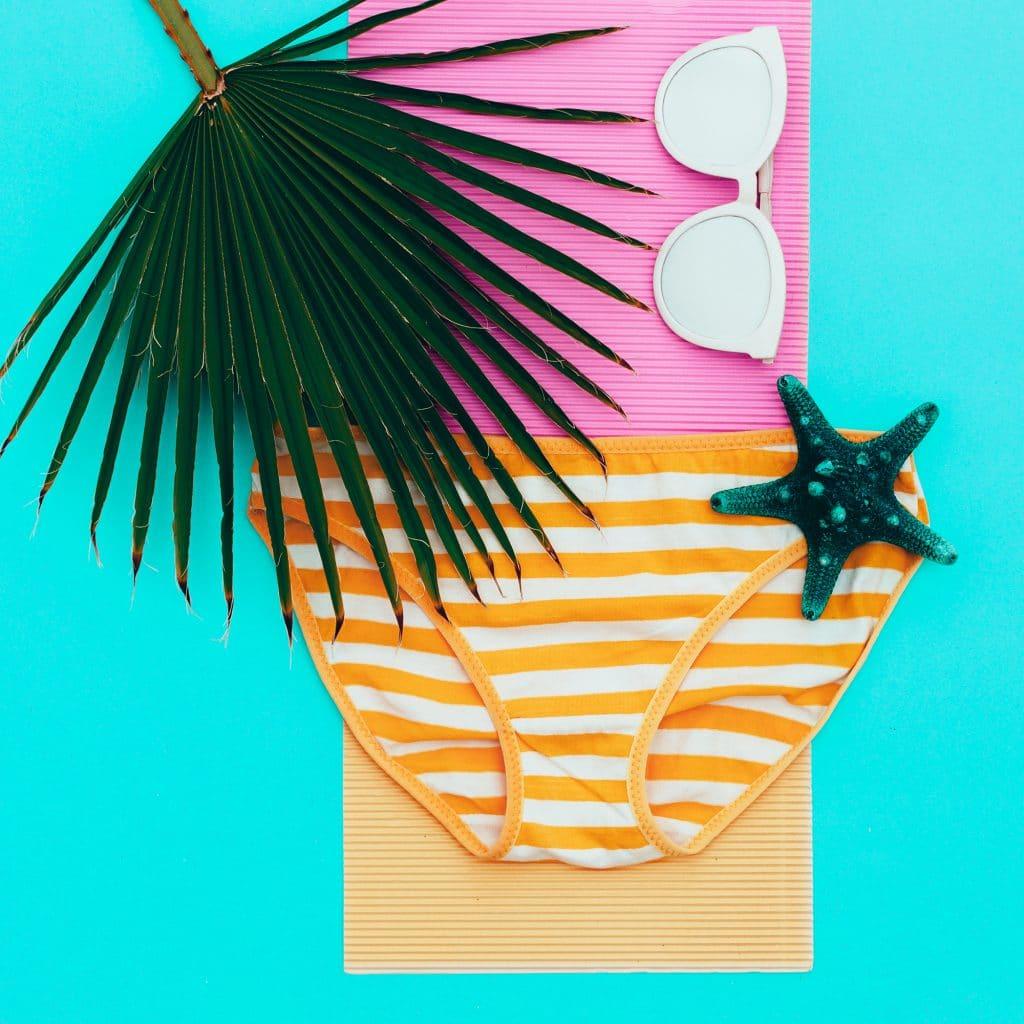 Striped swimsuit and sunglasses. beach minimal