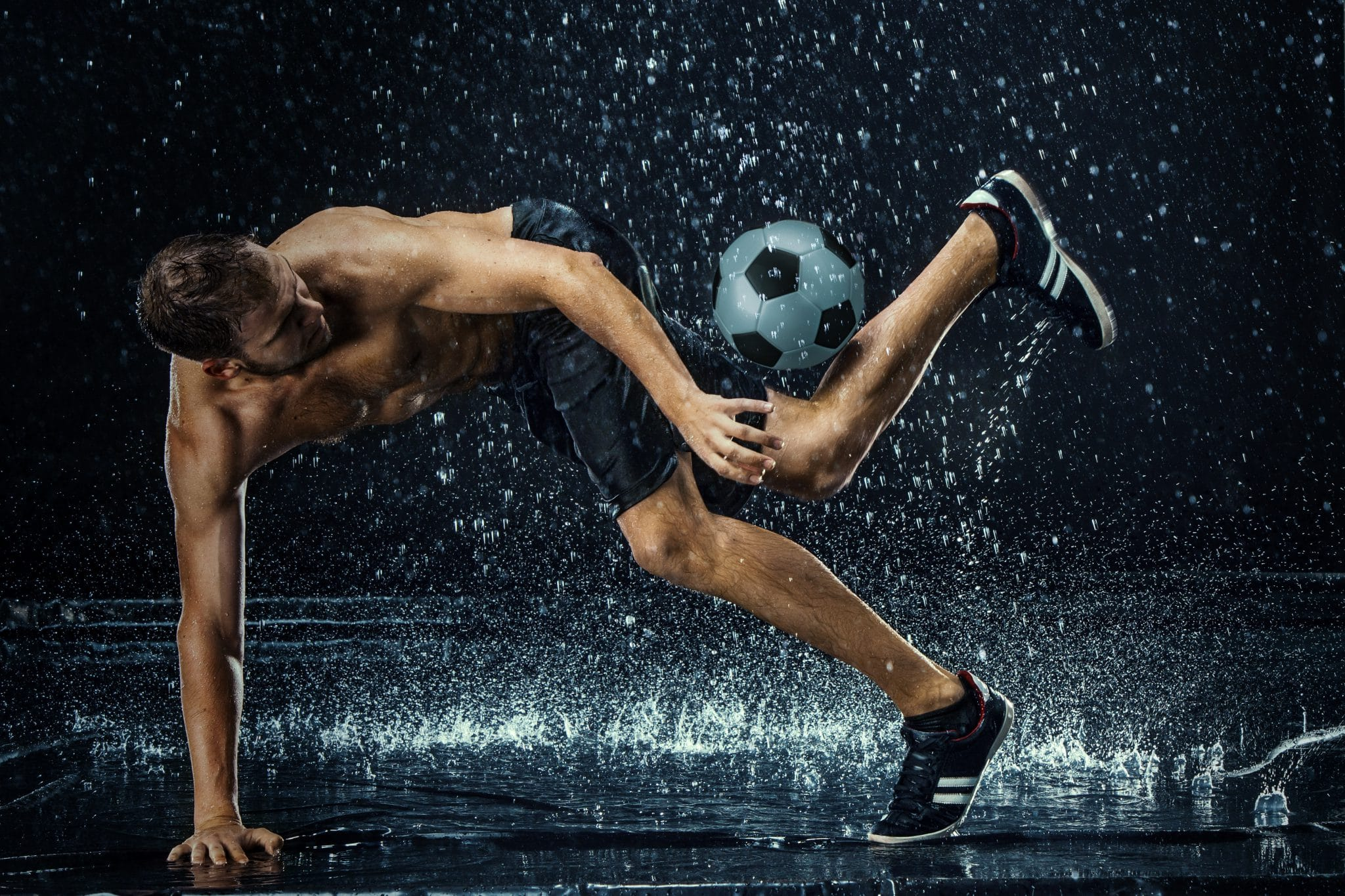 water-drops-around-football-player-PHSDVBK
