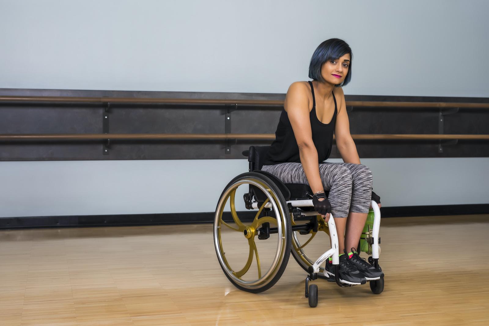 women in wheelchair in a gym studio