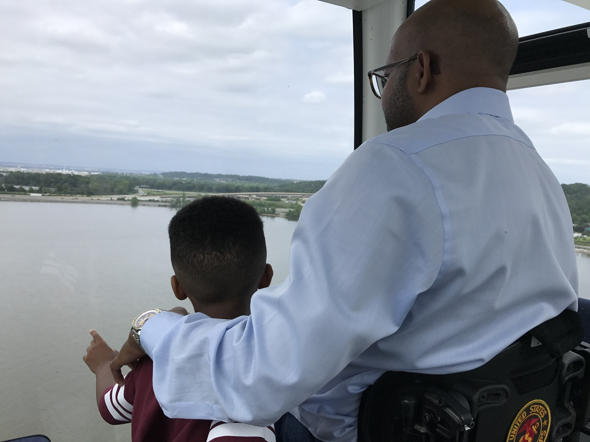 Sherman and his son looking out at a body of water