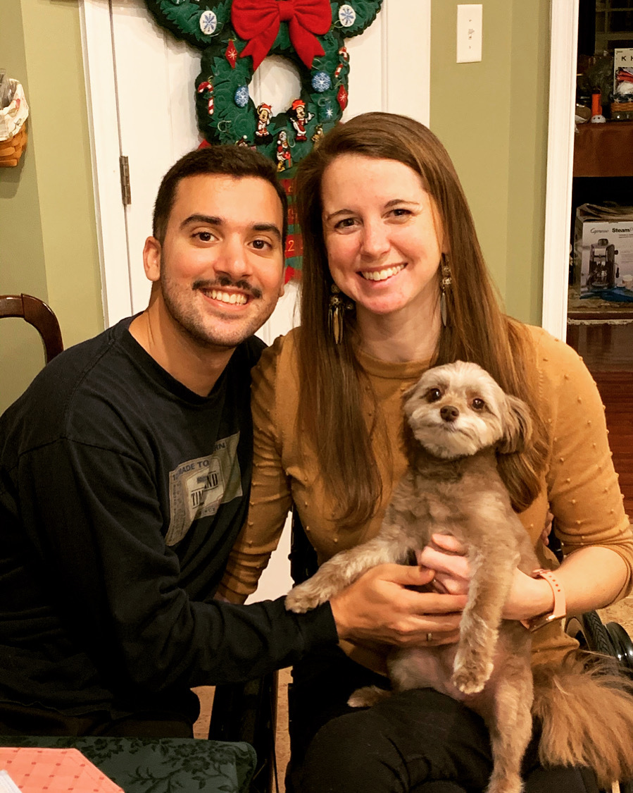 Kristin and her fiancé holding their dog