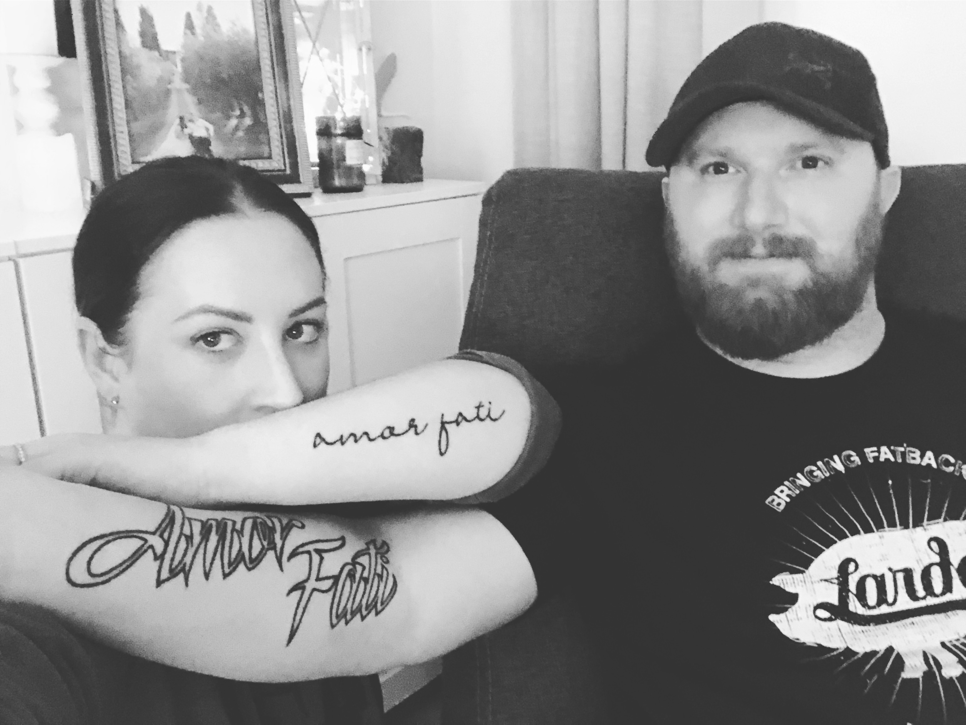 "Brooke and her husband showing their ""Amor Fati"" tattoos"