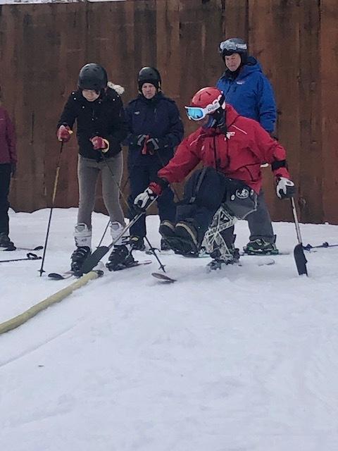 Geoff teaching skiing lessons