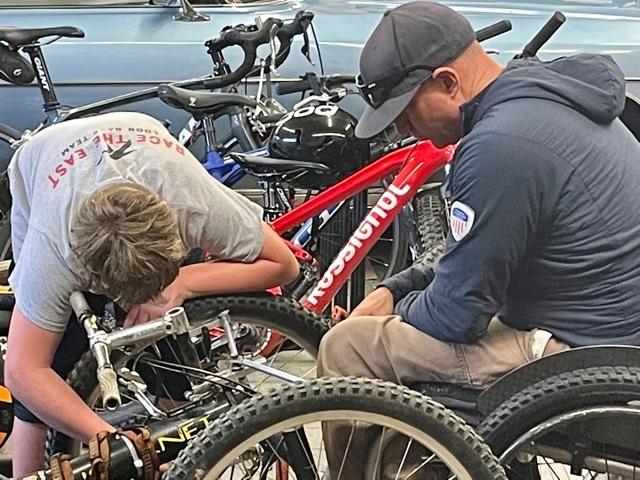 Geoff Krill next to mountain bikes