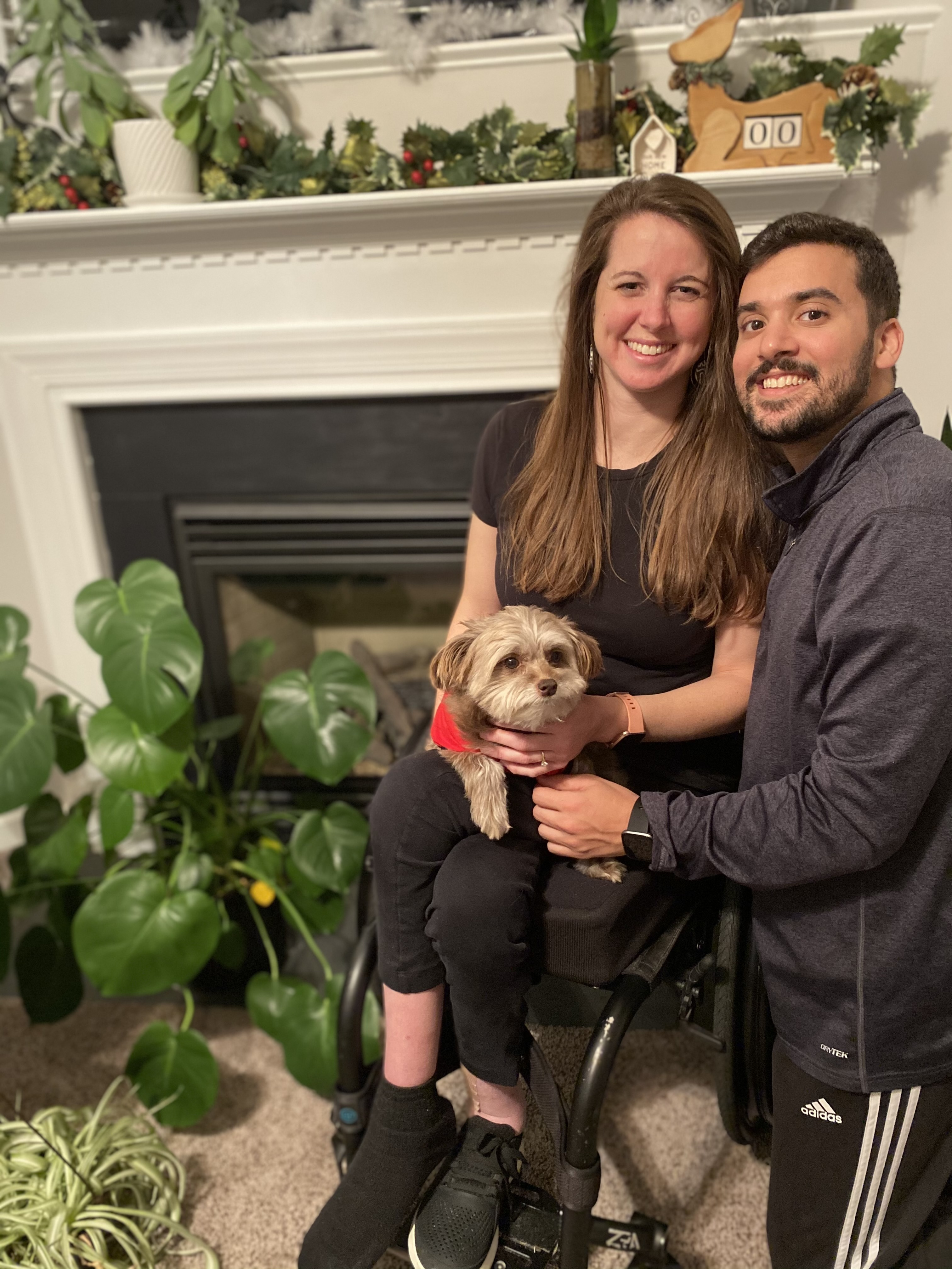 Kristin, her fiancé, and their dog smiling