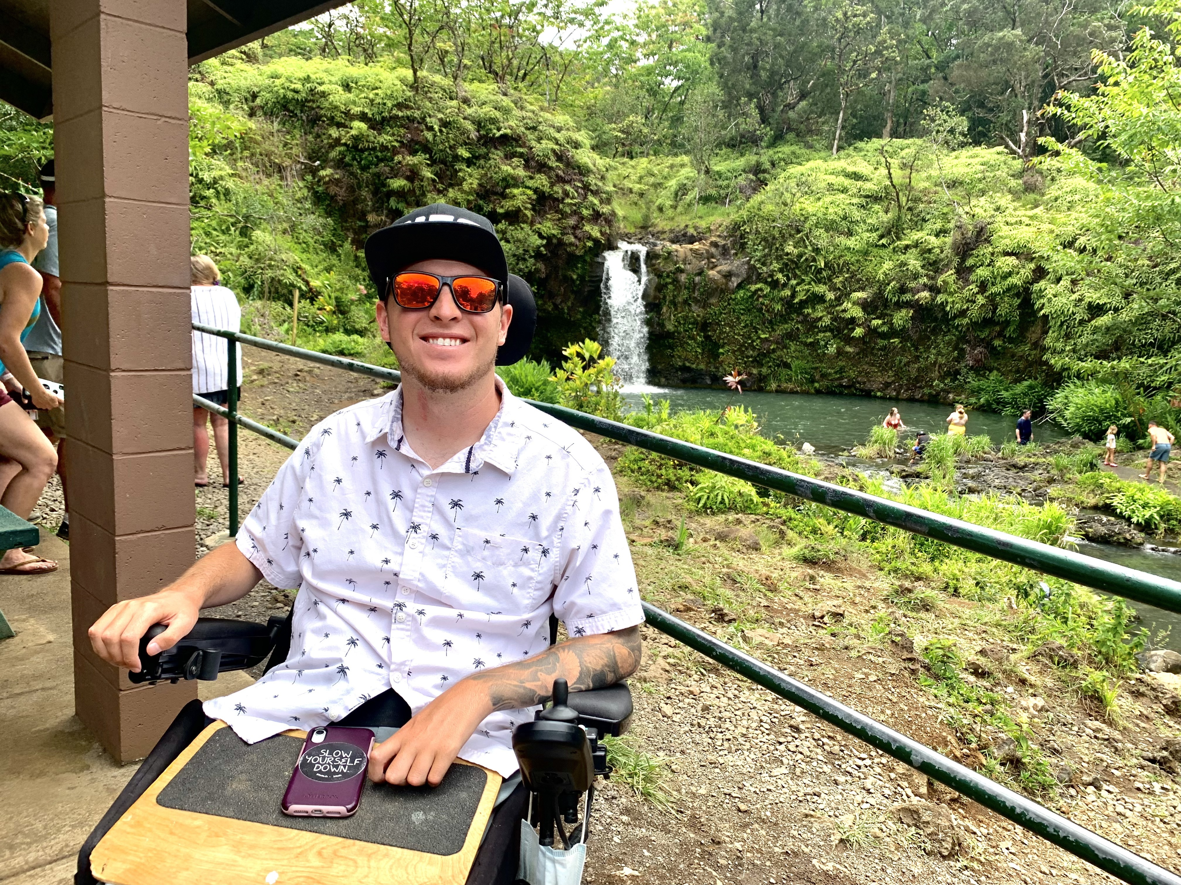 Zack in Maui in front of a waterfall