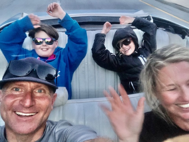 Krill family riding in convertible