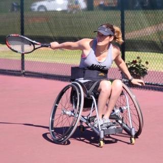 Jen playing tennis