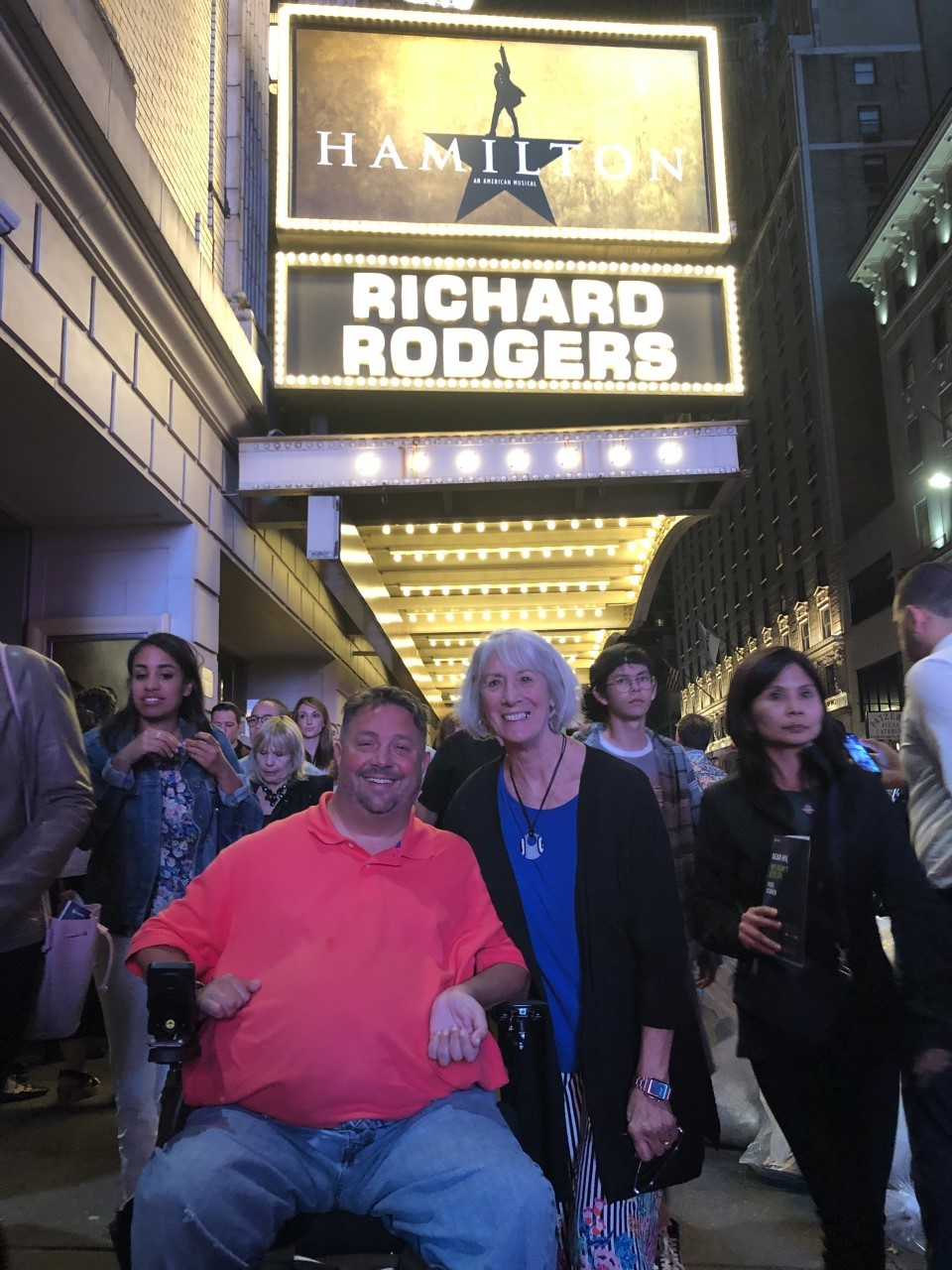 Kathy and TJ Griffin in front of Hamilton Broadway