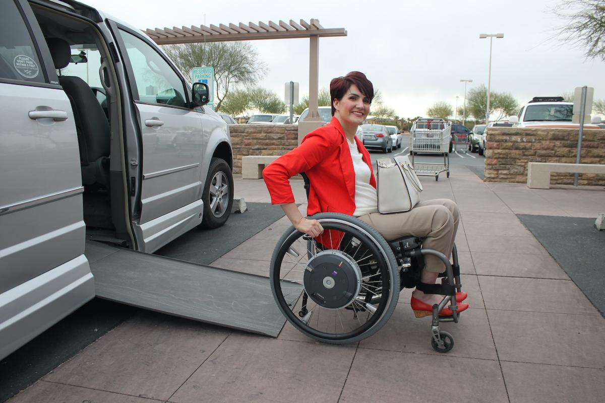 woman in wheelchair exiting her van