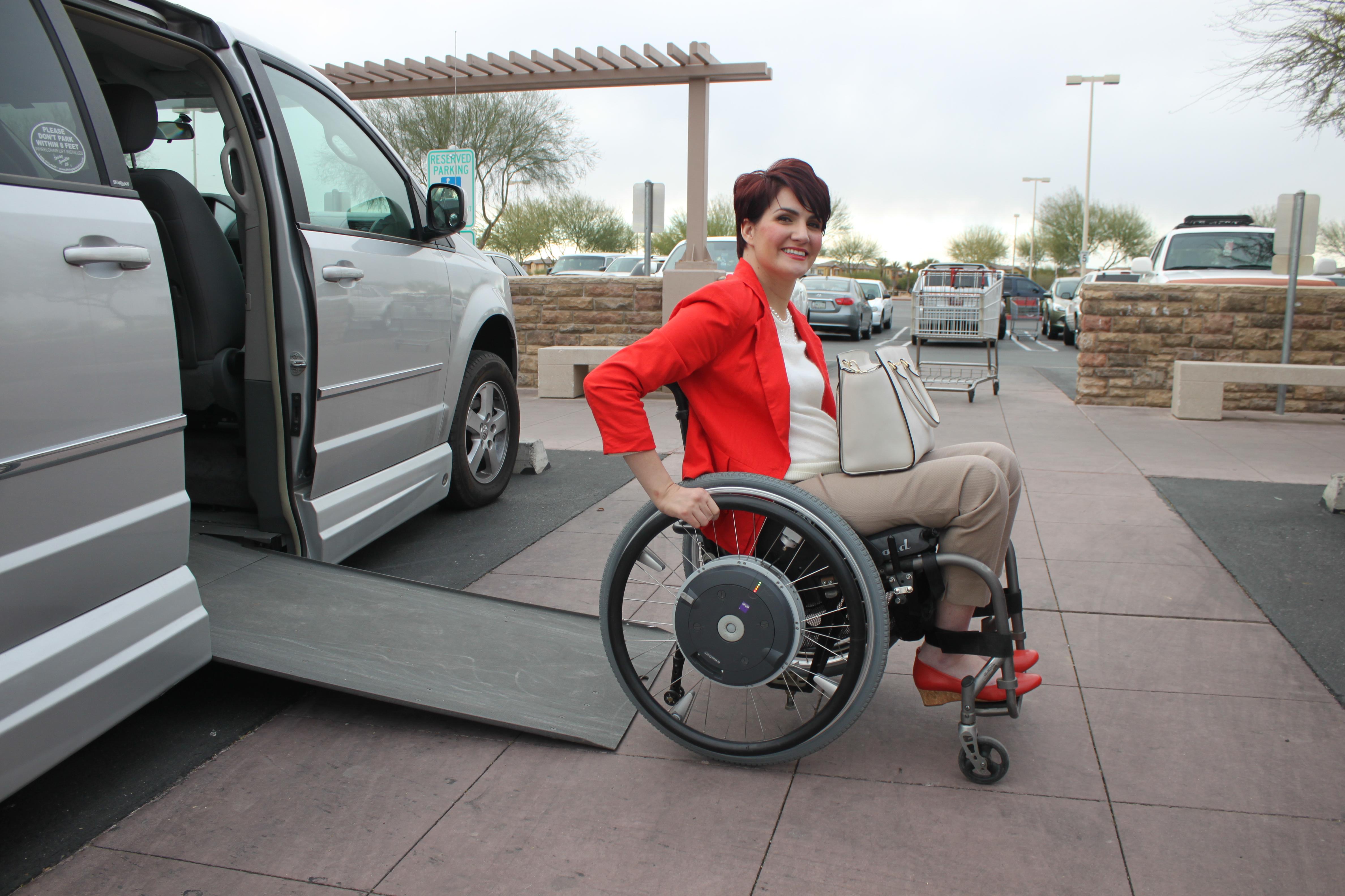 woman in wheelchair exiting van
