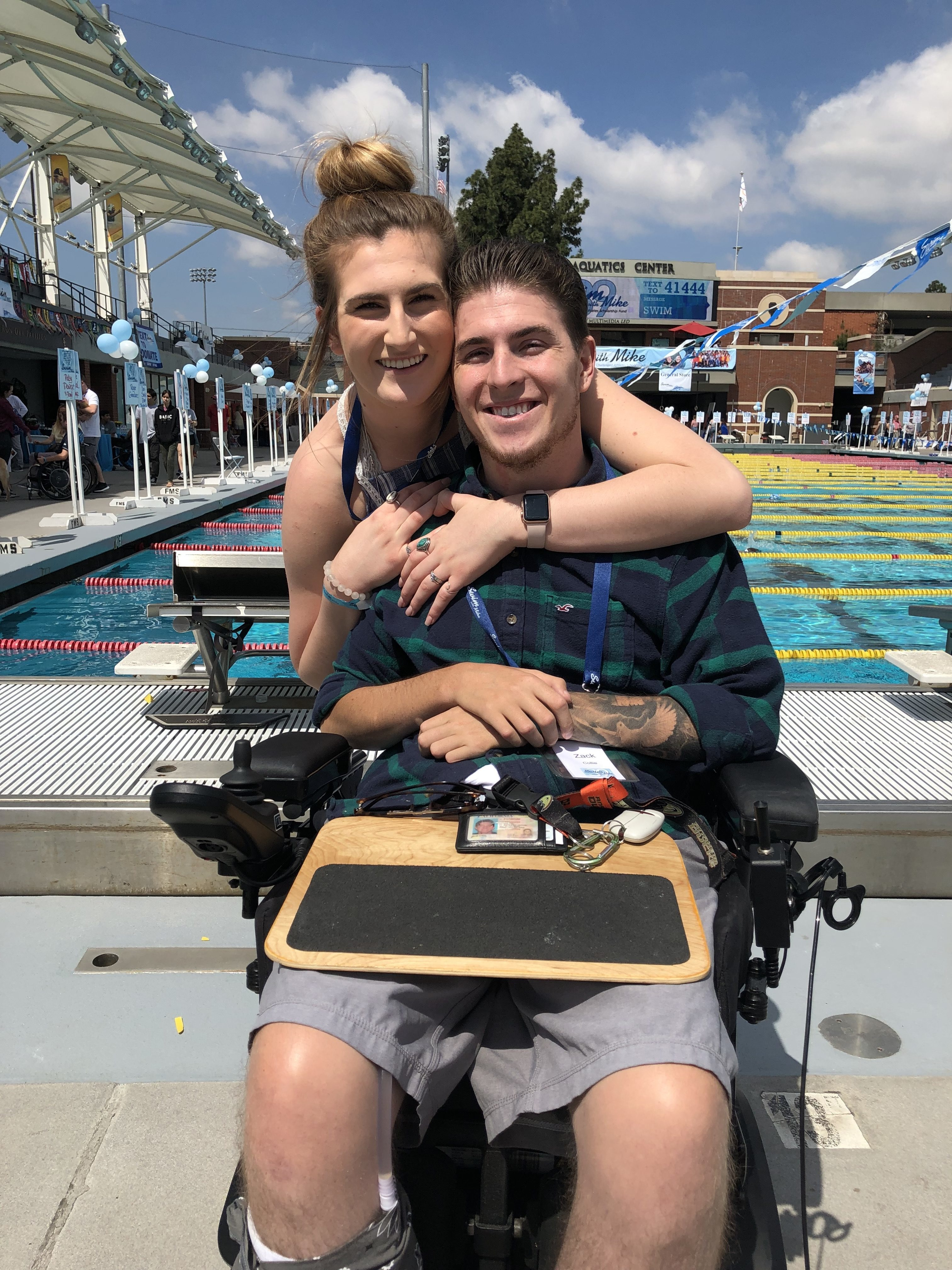 Zach and partner in front of pool