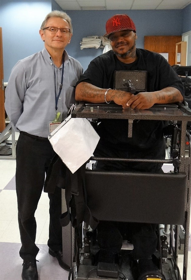 Former Resident Darrius with Cheshire's Director of Physical Therapy, Bill Hadewycz.