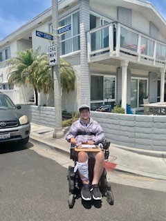 Zack outside in his wheelchair