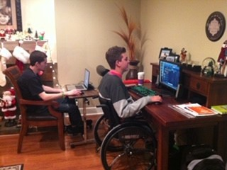 Zack Collie and Dylan with their video game setup