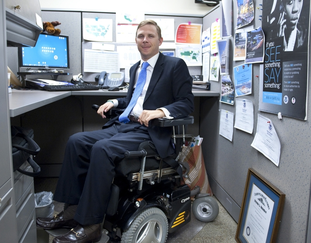 Taylor Price, at work at his desk at the Department of Homeland Security.