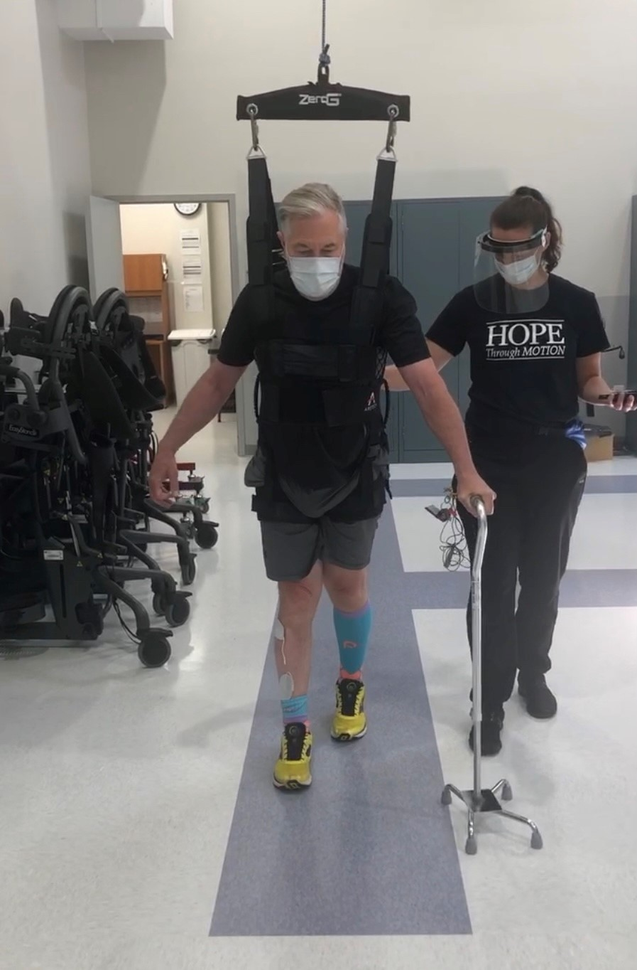 Howard completing exercises during therapy