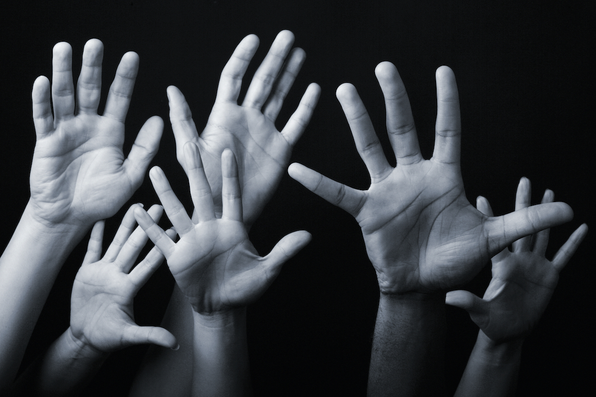 gray and white image of hands