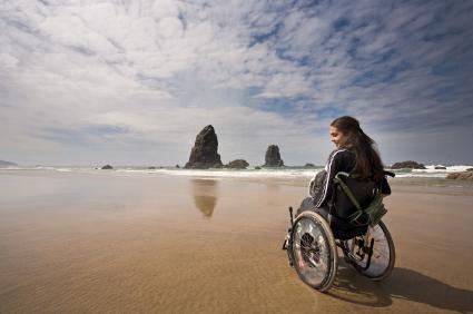 woman in wheelchair on the beach
