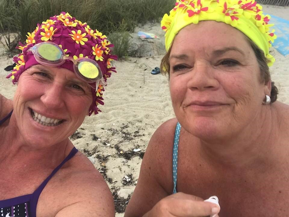 Leona and Kerry- Part of the Flower Cap Gals. They wear the caps so they can see each other in the ocean.