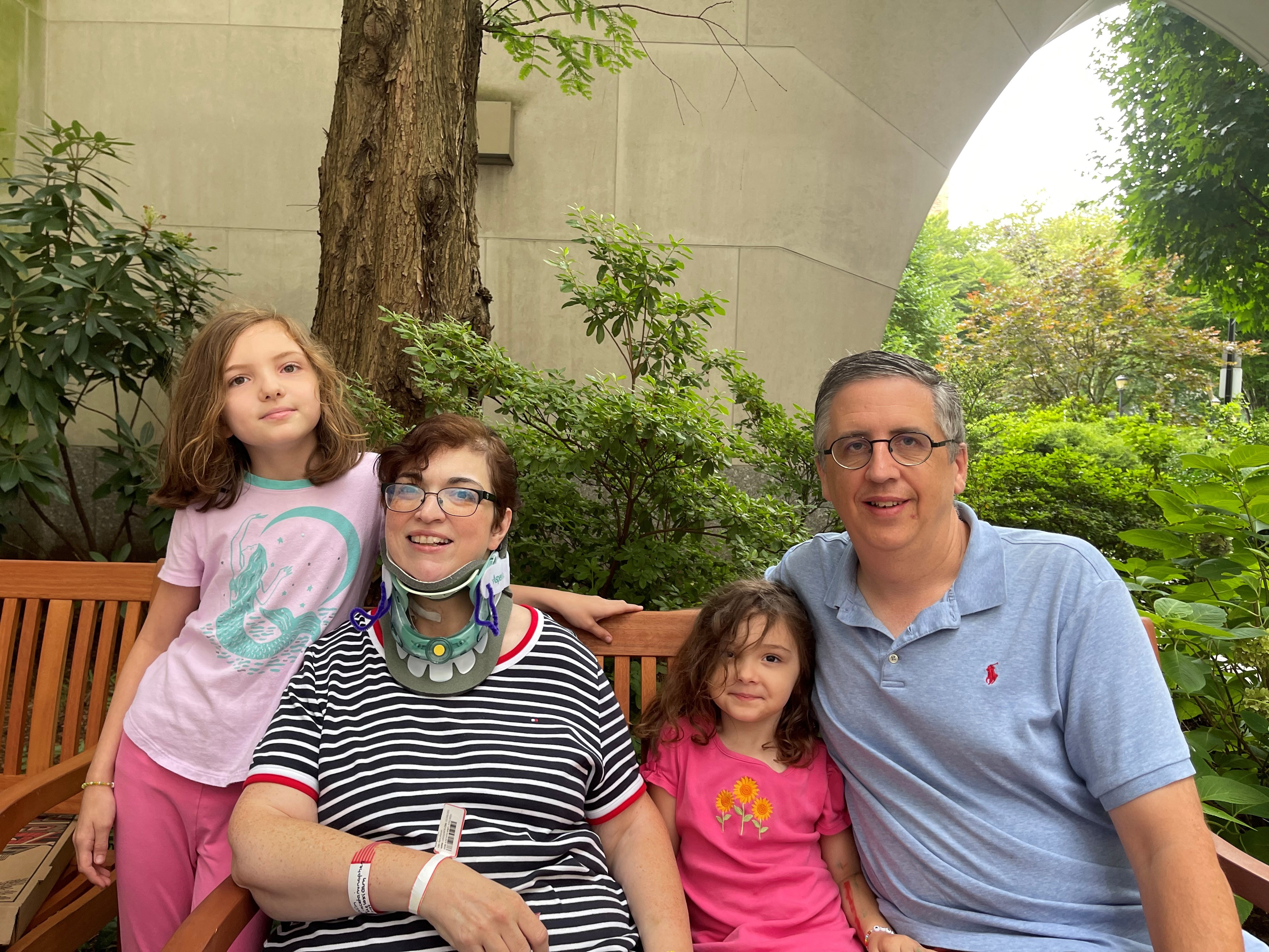 Kern family posing together while sitting on a bench outside