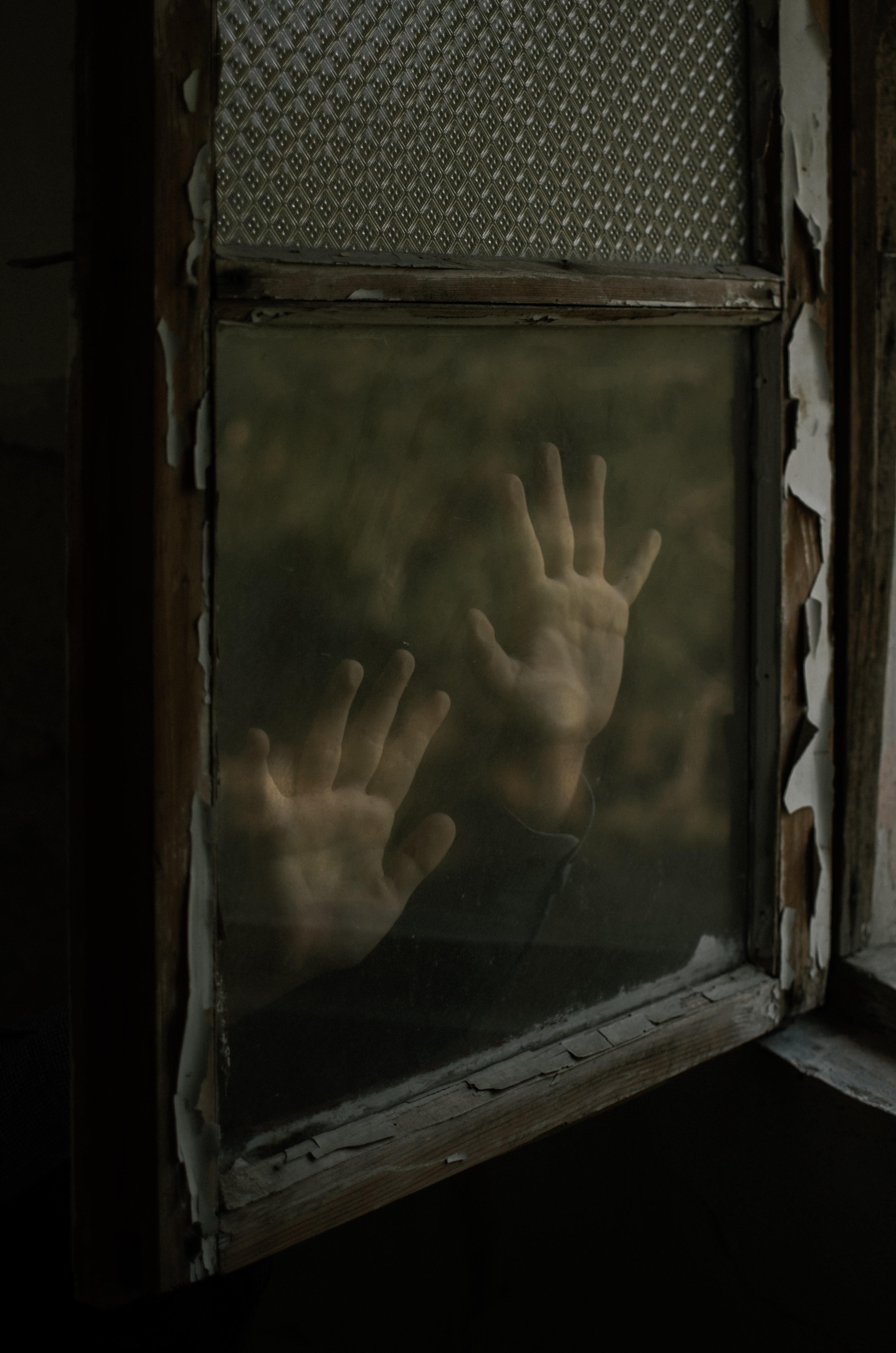 Hands on a window