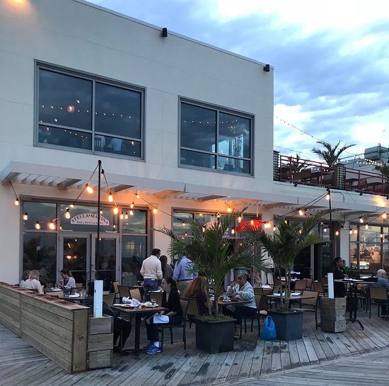 Stella Marina has accessible seating both inside the establishment, as well as on their outdoor patio with an ocean view.