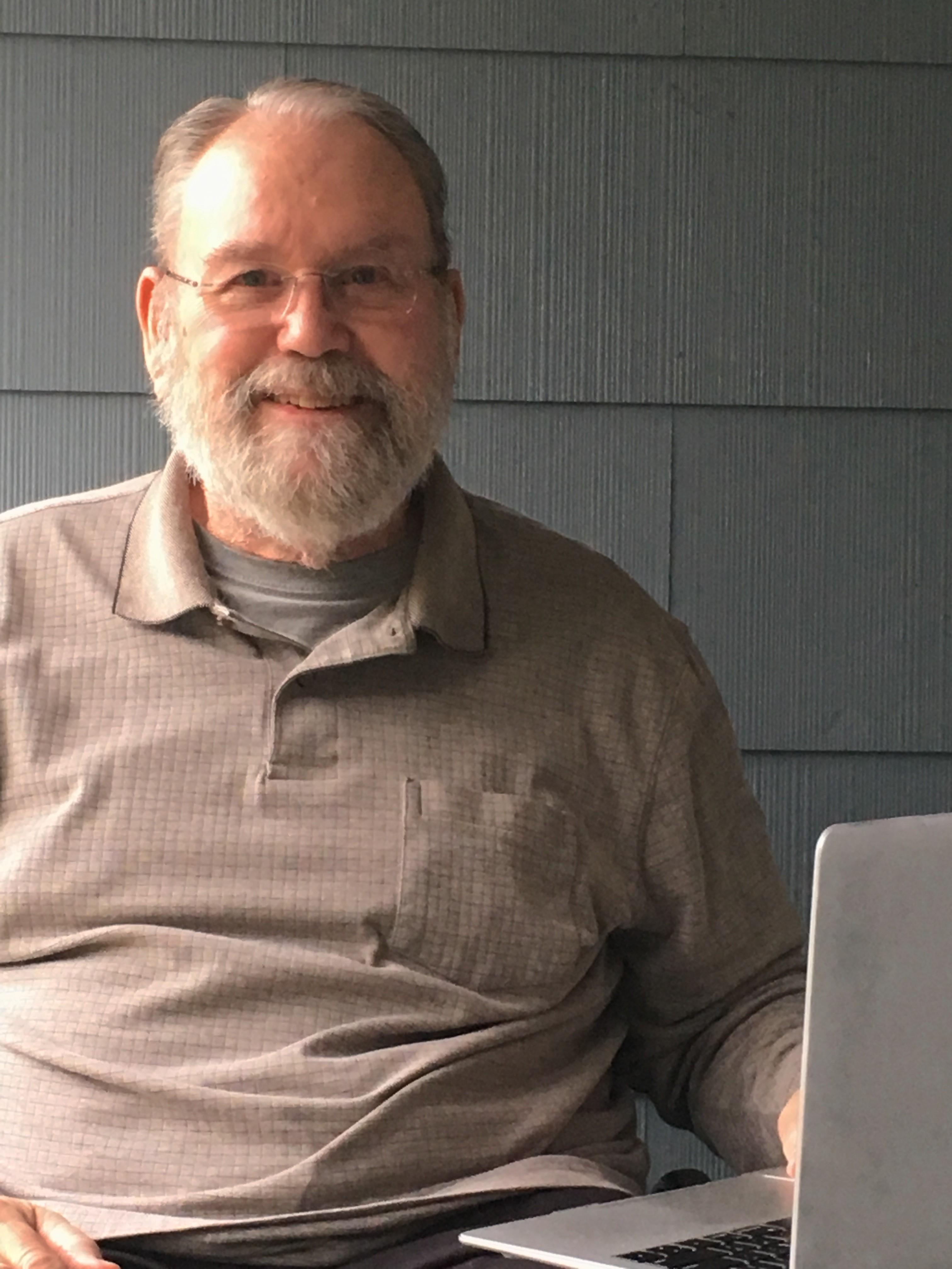 Tim holding laptop