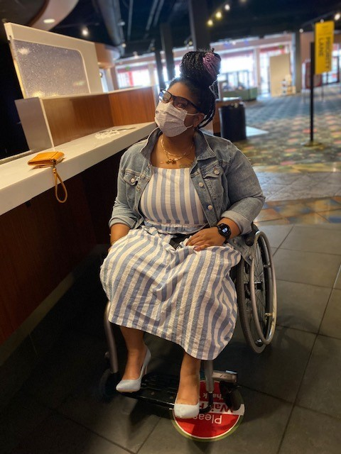 Tyra wearing striped dress and face mask