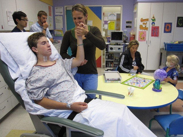 Zack undergoing physical therapy in the hospital