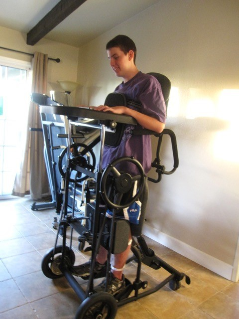 Zack Collie on his standing frame