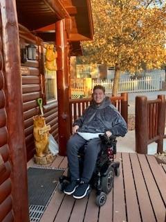 Zack outside cabin