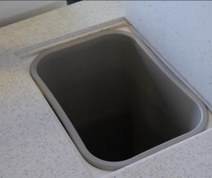 Hidden Refreshment Center Trash Compartment