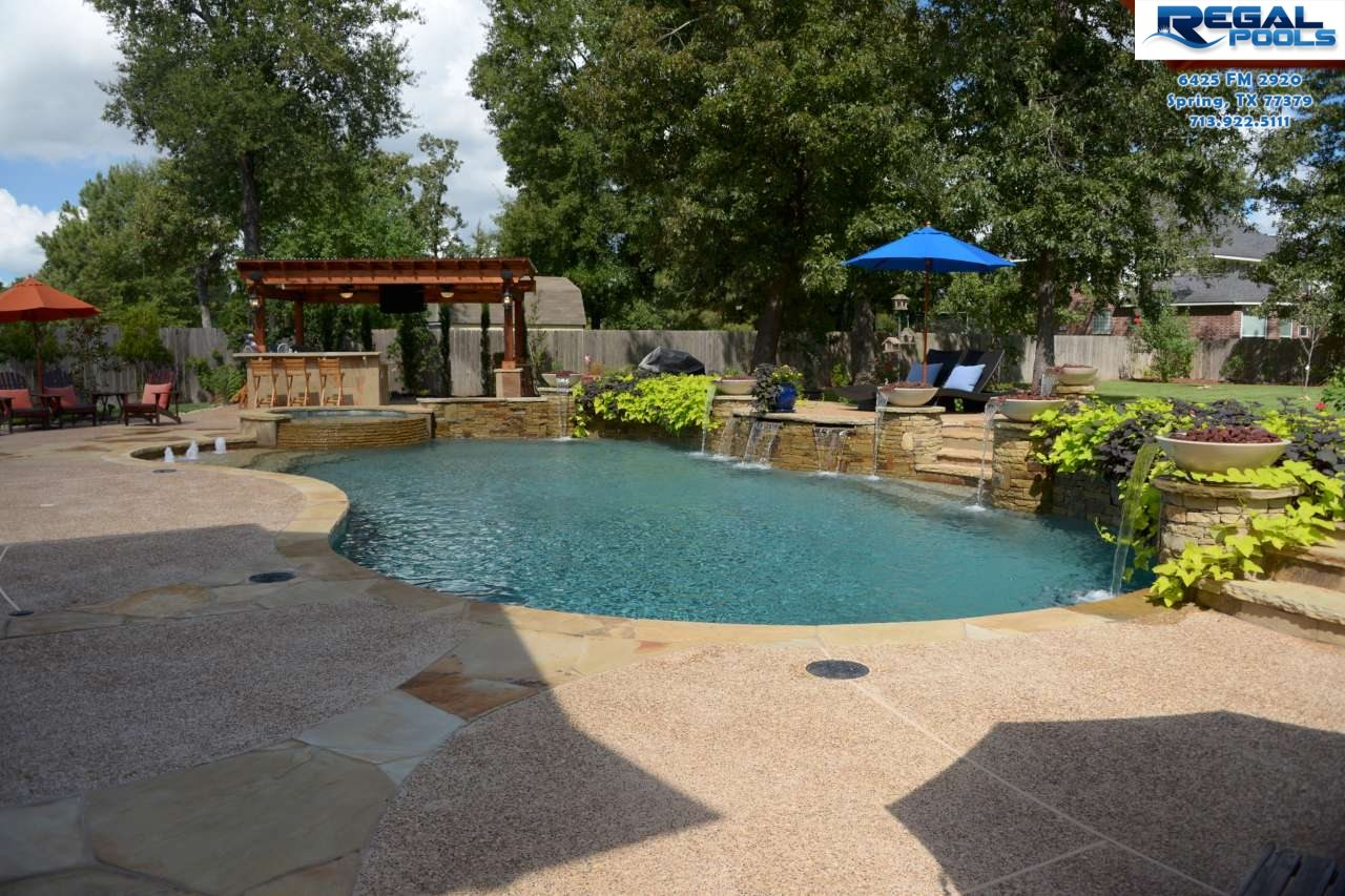 Pool designs gallery regal pools the woodlands tx for Custom swimming pool designs